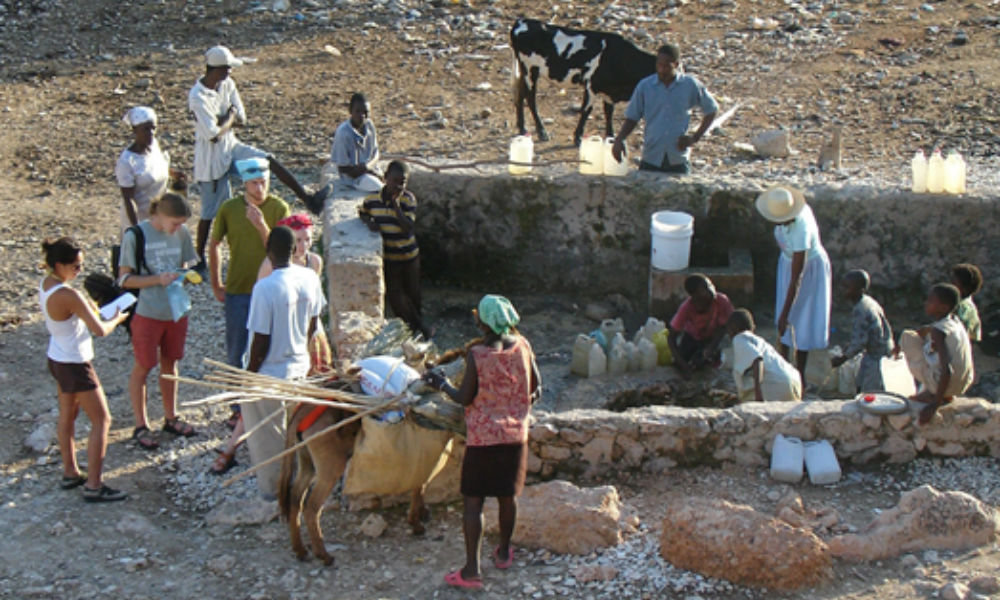 JMU students at well in Mahotierre