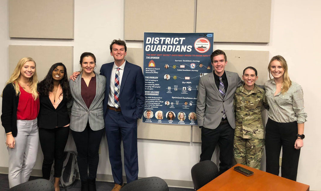 Major Laura Keenan from the D.C. National Guard visits JMU to watch the students present their solution.