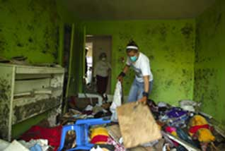 JMU workers clear a Katrina-Ravaged house in Biloxi.