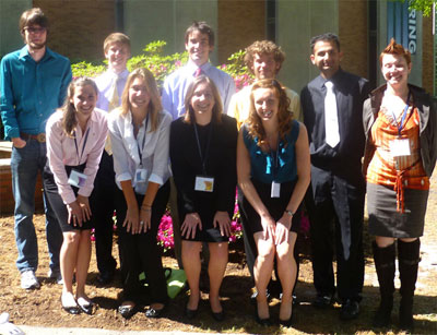 JMU students who presented research at the conference pose outside a building at Old Dominion University.