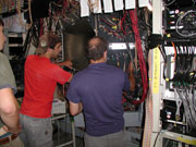 Dr. Giovanetti and student check signal cabling.