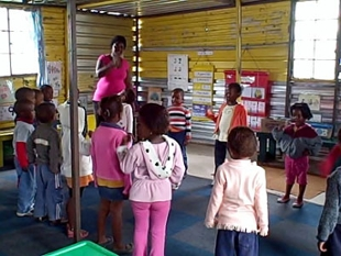 Teacher leading a preschool class
