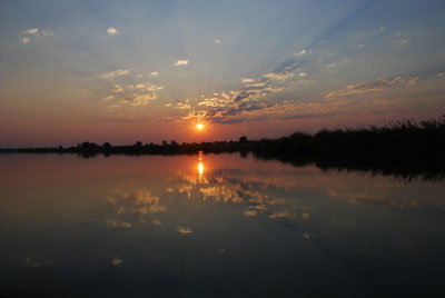 sunset over Kavango River in Namibia.