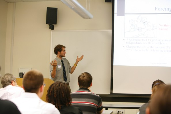 A student gives an oral presentation in a classroom.