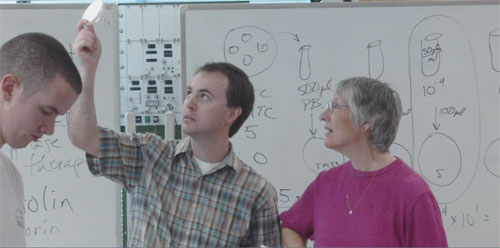 Assistant Professor of Biology Steve Cresawn and ISAT professor Louise Temple check a student's experiment
