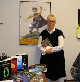 Elisabeth Gumnior poses with Harry Potter books in her office.