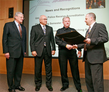 officers receive accreditation plaque