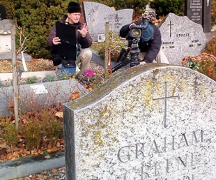 Photo of filmmaker Tom O'Connor with videographer setting up a shot in a cemetary