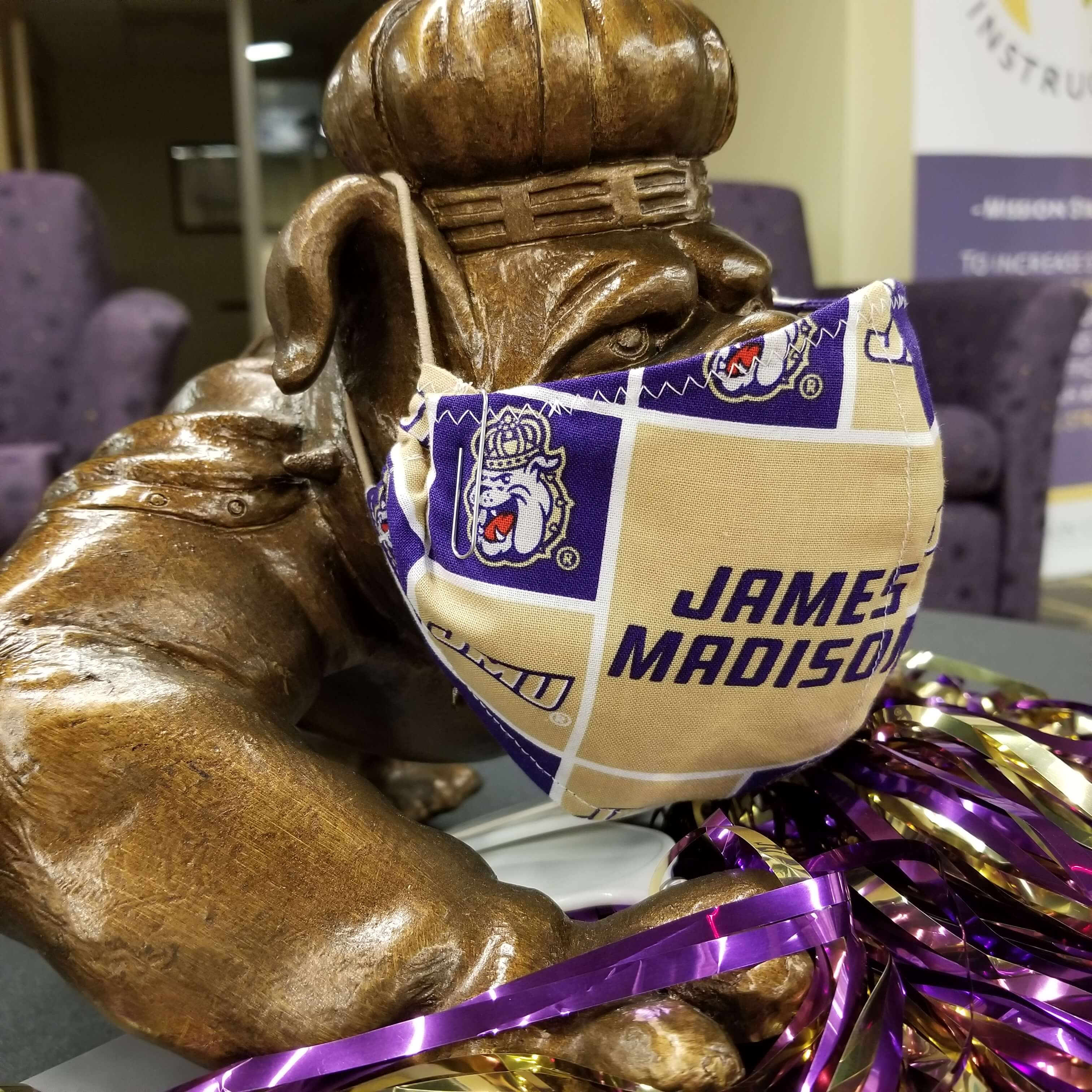 The duke dog with a JMU themed cloth mask